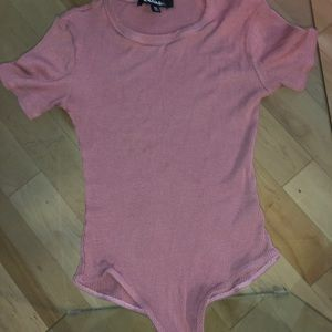 Pink T-shirt style body suit/leotard.